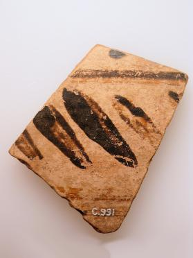 Fragment of an East Greek closed vessel decorated in slip with a pattern