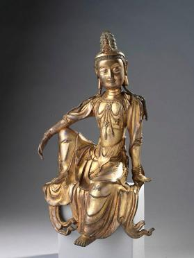 Figure of Guanyin (Avalokitesvara) seated in royal ease