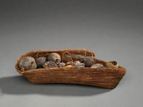 Basket filled with carbonized fruit