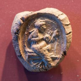 Seal impression of Isis suckling Harpokrates on a throne, both crowned