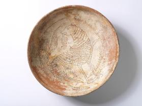 Bowl depicting a wild beast with a leafy branch in its mouth