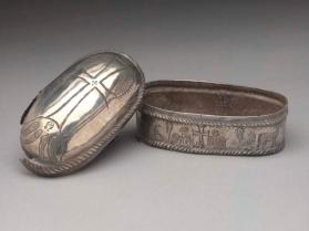 Lid of oval-shaped reliquary casket with the Cross