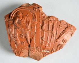 Body sherd of a Samian ware bowl with Hephaistos and a gladiator