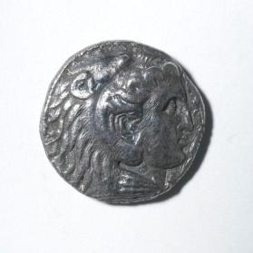 Coin (tetradrachm) of Alexander the Great, head in lion's skin headdress