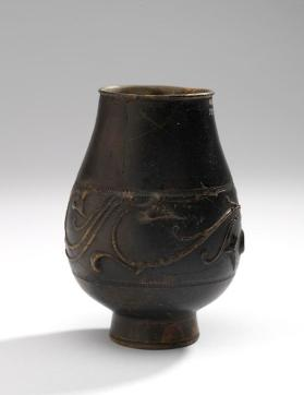 Beaker decorated with S-shaped scrolls and heart-shaped leaves