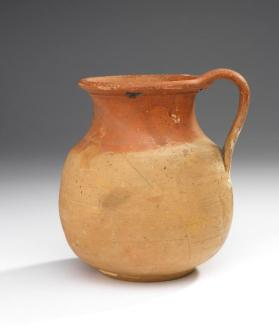 Jug with partial orange slip