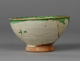 Footed cup decorated with sgrafitto of a human head in profile