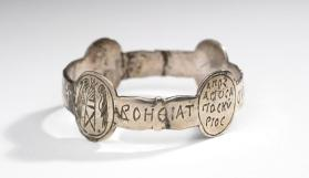 Inscribed armband with four oval medallions