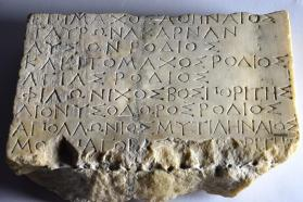 Slab with inscription in Greek