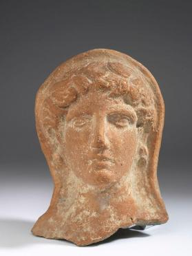 Female votive head