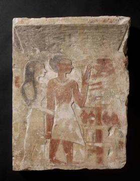 Stela depicting husband and wife making offering