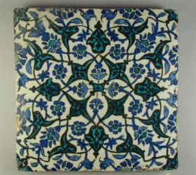Tile with split-palmettes and floral vines in cobalt blue and turquoise