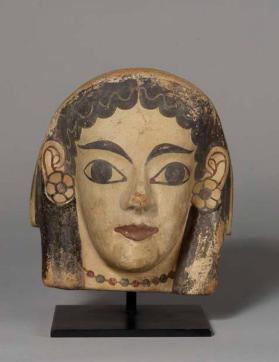 Fragmentary antefix with a female head