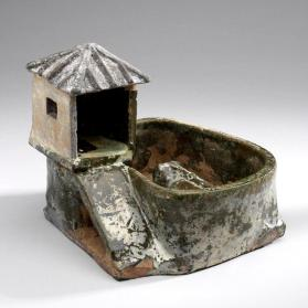 Burial model of a pig sty and privy