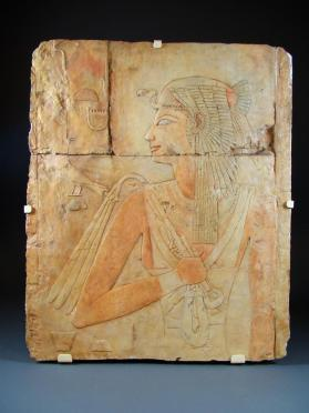 Relief, modern cast, Queen Ahmose carrying fly whisk