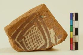 Turquoise slip-painted vessel fragment (base sherd)