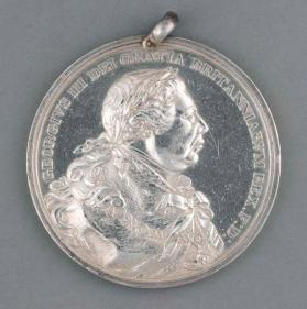 Indian peace medal commemorating the end of the War of 1812