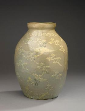 Celadon jar with inlaid peony, cloud, and crane design 청자상감모란운학문편호