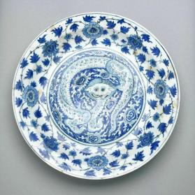 Dish with dragon in firey clouds, head and paws of lion