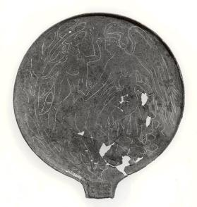 Fragmentary mirror with trace of iron rivetted handle