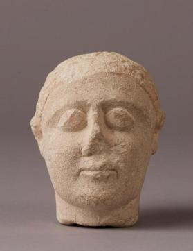 "Head of a votive figure, ""temple boy"" type"