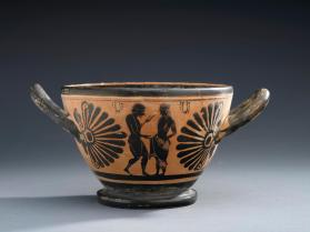 Attic black-figure cup showing a scene of two men courting