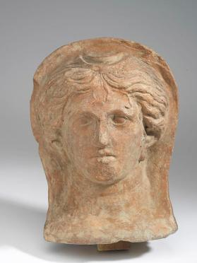 Votive female head