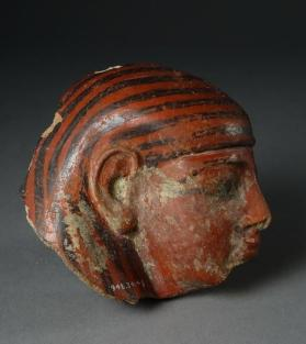 Canopic jar lid in shape of human head