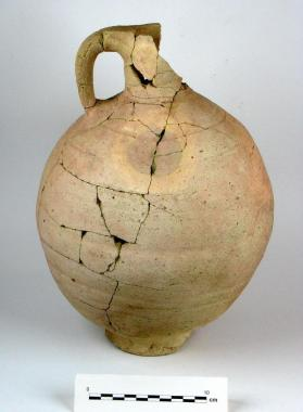 One-handled flagon with strainer in neck