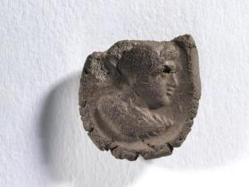 Seal impression of male bust wearing diadem, cuirass, cloak