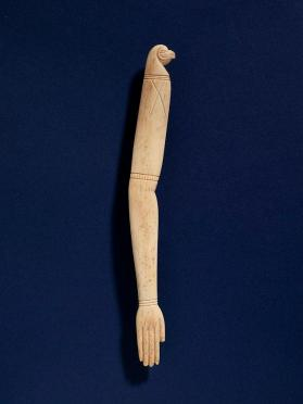 Amuletic wand in the form of a hand at one end and bird-like head on the opposite