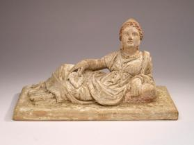 Cinerary chest lid with reclining woman
