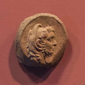 Seal impression with bust of Ptolemy IX Soter II wearing a lion skin