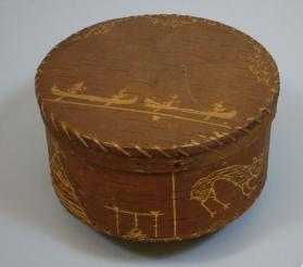 Birchbark box with scraped images of canoes, animals, snowshoes, bow and arrow, and camp