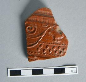 Wall fragment from a Samian ware bowl compound scroll motif