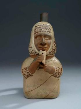 Effigy vessel depicting a man playing a flute