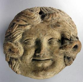 Wall plaque with mask of Medusa