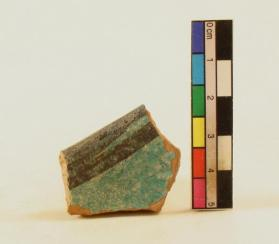 Turquoise black-painted bowl fragment (rim sherd)