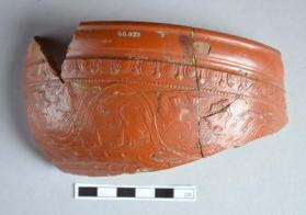 Fragment of a Samian ware bowl with a scrolling ivy wreath pattern