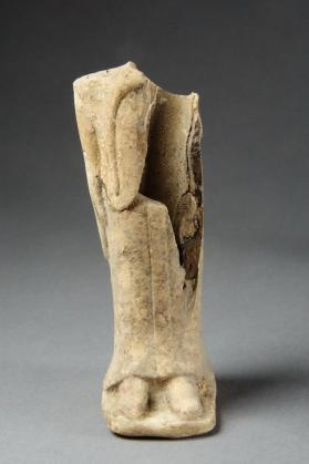 Female votive figure wearing chiton and himation