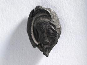 Seal impression with head of Athena wearing a crested Corinthian helmet