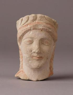 Head of a wreathed female figure