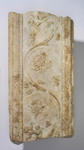 Fragment of a pilaster decorated with vine scroll populated with cupids