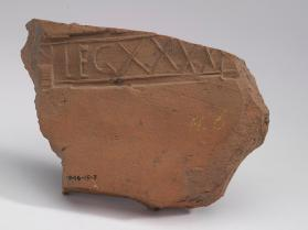 Fragment of a roof tile stamped: LEGXXVV