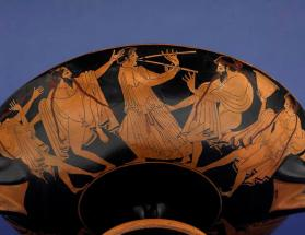 Attic red-figure kylix with revellers from a drinking party