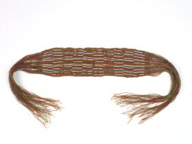 Heddle-woven garter with fringes