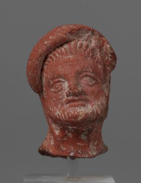 Fragment of a male figurine with heavy fillet over forehead