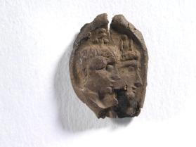 Seal impression of male and female busts, both crowned