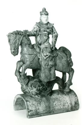 Ridge tile with a mounted warrior