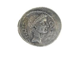 Denarius with head of Julius Caesar (obverse) and Venus seated holding Victory (reverse)
